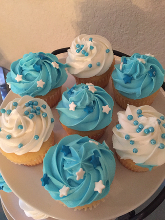 Trays of delicious cupcakes during celebration party. Banco de Imagens