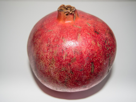 punica granatum: Pomegranate (Punica granatum) is a fruit-bearing deciduous shrub or small tree growing between 5 and 8 m (16 and 26 ft) tall.
