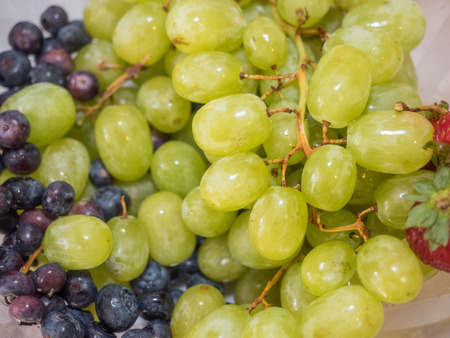 clusters: Bowl of various types of grape clusters.