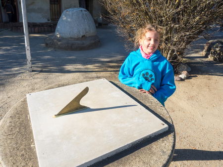 apparent: Sundial is a device that tells the time of day by the apparent position of the Sun in the sky. In common designs such as the horizontal sundial, the sun casts a shadow from its style onto a surface marked with lines indicating the hours of the day.