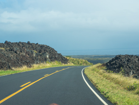 hardened: Chain of Craters Road is a 19-mile winding paved road through the East Rift and coastal area of the Hawaii Volcanoes National Park on the island of Hawaii. Stock Photo