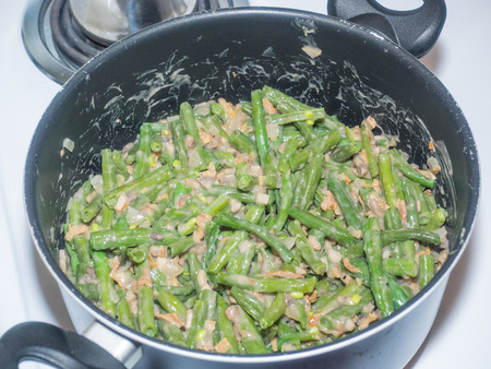 Green bean casserole is a casserole consisting of green beans, cream of mushroom soup, and french fried onions. It is a popular Thanksgiving side dish in the United States.