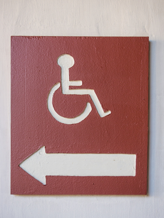 wheelchair access: International Symbol of Access (ISA) consists of a blue square overlaid in white with a stylized image of a wheelchair.