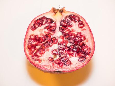 granatum: Pomegranate (Punica granatum) is a fruit-bearing deciduous shrub or small tree Stock Photo