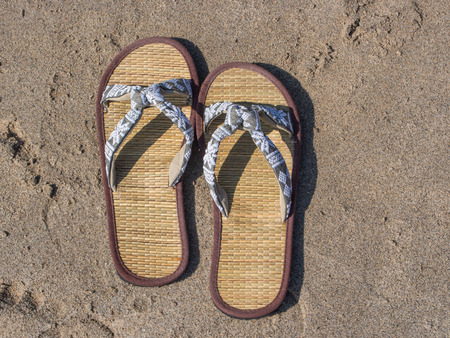 Flip-flops are a type of open-toed footwear sandal, typically worn as a form of casual wear. Stock Photo