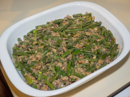 green bean: Green bean casserole is a casserole consisting of green beans, cream of mushroom soup, and french fried onions. It is a popular Thanksgiving side dish in the United States.