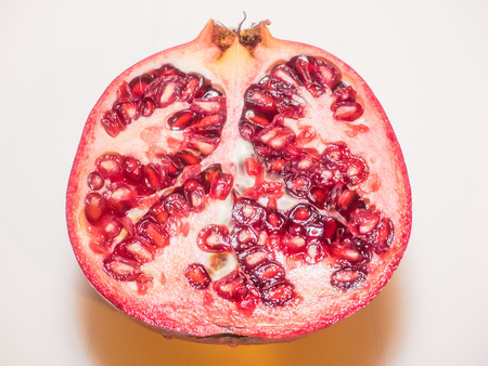 Pomegranate (Punica granatum) is a fruit-bearing deciduous shrub or small tree growing between 5 and 8 m (16 and 26 ft) tall.
