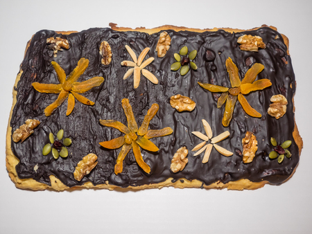 recipe decorated: Traditional Polish cake make for Easter with variety of toppings. Mazurek is usually colourfully iced and decorated with jam, nuts and raisins. Stock Photo
