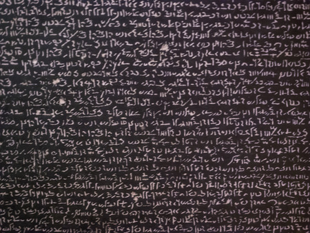 Rosetta Stone is a rock stele, found in 1799, inscribed with a decree issued at Memphis, Egypt, in 196 BC on behalf of King Ptolemy V.