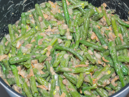 popular soup: Green bean casserole is a casserole consisting of green beans, cream of mushroom soup, and french fried onions. It is a popular Thanksgiving side dish in the United States.
