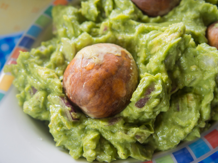 Guacamole served with avocado pits to keep the mix from turning brown. Stock Photo