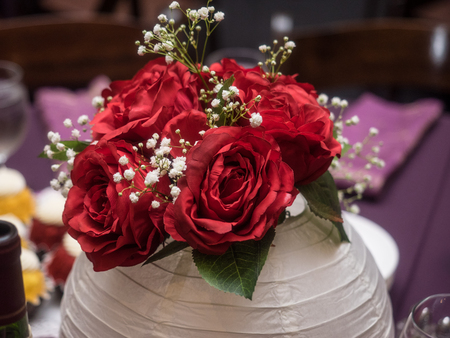 Bouquet of beautiful red roses with white babys breath backdrop
