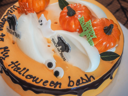 Spooky Halloween chocolate layer cake with decorations on top.
