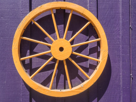 Wooden wagon wheel with flat steel tire and wood spokes