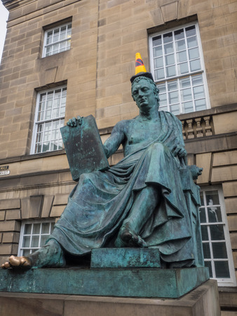 touchstone: Statue of David Hume on the Royal Mile in Edinburgh.