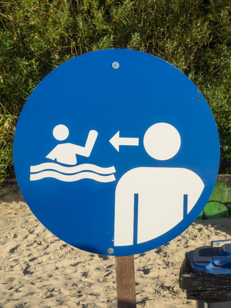 informing: Blue sign informing about lifeguard on duty.