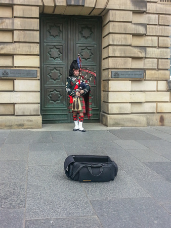 bagpipe: Bagpiper busking with the Great Highland bagpipe on the street in Edinburgh, Scotland