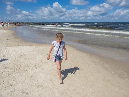 Enjoying warm summer day on the beach in Kolobrzeg.
