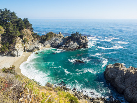 McWay Falls is an 80-foot waterfall located in Julia Pfeiffer Burns State Park that flows year-round. Stock Photo