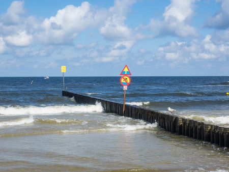 Breakwaters are structures constructed on coasts as part of coastal defense or to protect an anchorage from the effects of both weather and longshore drift.
