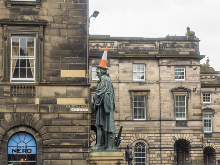 free enterprise: Statue of Adam Smith, philosopher and father of modern economics thinking, faces down the high street in Edinburgh.