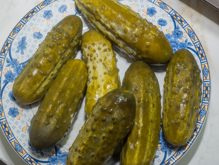 acidic: Pickled cucumber is a cucumber that has been pickled in a brine, vinegar, or other solution and left to ferment for a period of time, by either immersing the cucumbers in an acidic solution or through souring by lacto-fermentation.