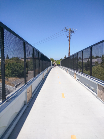 The Permanente Creek Trail is a multi-use trail that extends from Shoreline At Mountain View over Highway 101, under Old Middlefield Road and currently ends at Rock Street. Stock Photo