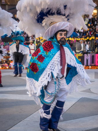 flower parade: Redwood City, CAUSA - November 6, 2016: Dia de Los Muertos celebration to tonor the dead with a parade and party in downtown Redwood City. The celebration will include music, kids activities, traditional food, vendors and altars contest at the San Mateo