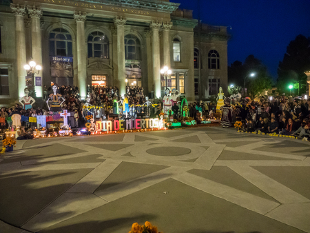 procession: Redwood City, CAUSA - November 6, 2016: Dia de Los Muertos celebration to tonor the dead with a parade and party in downtown Redwood City. The celebration will include music, kids activities, traditional food, vendors and altars contest at the San Mateo
