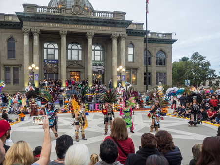 processions: Redwood City, CAUSA - November 6, 2016: Dia de Los Muertos celebration to tonor the dead with a parade and party in downtown Redwood City. The celebration will include music, kids activities, traditional food, vendors and altars contest at the San Mateo