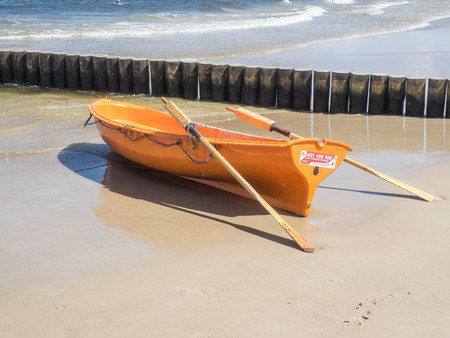 Orange lifeguard rowboat on the beach in Kolobrzeg Stok Fotoğraf