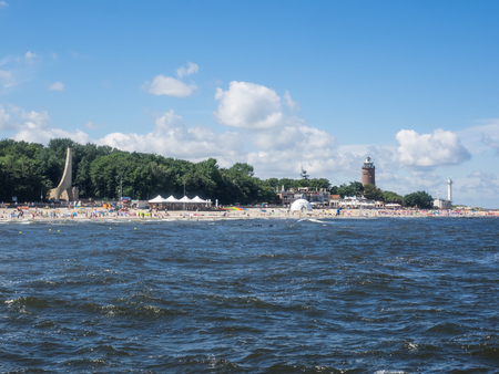 Coastline of the Baltic Sea in Ko?obrzeg and historical lighthouse. Standard-Bild