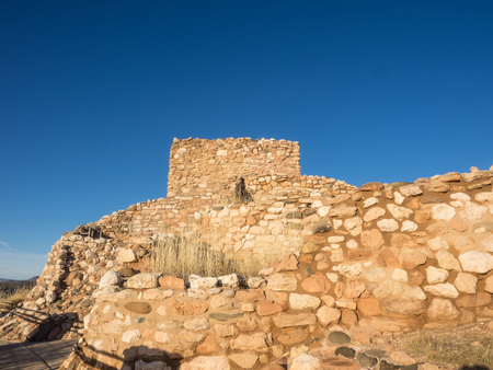 pueblo: Tuzigoot National Monument preserves a 2- to 3-story pueblo ruin on the summit of a limestone and sandstone ridge just east of Clarkdale, Arizona, 120 feet (36 m) above the Verde River floodplain.
