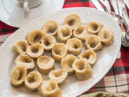 Uszka are small dumplings (a very small and twisted version of pierogi) usually filled with flavoursome wild forest mushrooms andor minced meat. Reklamní fotografie