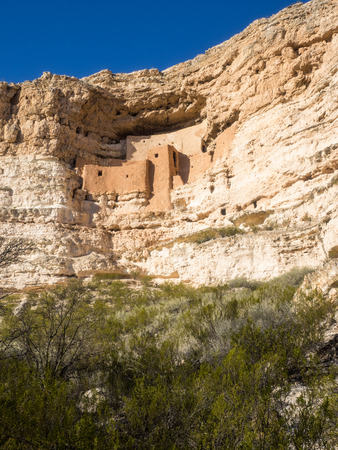 ancestral: Montezuma Castle National Monument protects a set of well-preserved Ancestral Puebloan cliff dwellings near the town of Camp Verde, Arizona, United States. The dwellings were built and used by the Sinagua people, a pre-Columbian culture closely related to Stock Photo