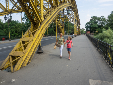 Zwierzyniecki (Zoo) Bridge is located in the eastern part of Wrocław, Poland. The bridge spans the Oder River and is in the immediate vicinity of Wrocław Zoo and the exhibition grounds about Centennial Hall. Stock Photo