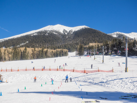 coconino national forest: Arizona Snowbowl is an alpine ski resort located on the San Francisco Peaks, 7 miles north of Flagstaff, Arizona. Editorial
