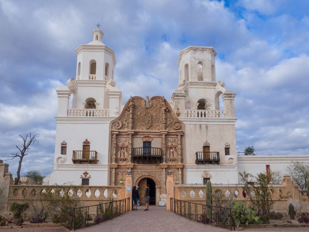 Mission San Xavier del Bac is a historic Spanish Catholic mission located about 10 miles (16 km) south of downtown Tucson, Arizona, on the Tohono Oodham San Xavier Indian Reservation.