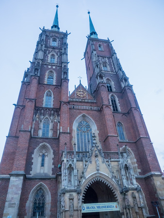 Cathedral of St. John the Baptist in Wroclaw is the seat of the Roman Catholic Archdiocese of Wroclaw and a landmark of the city of Wroclaw in Poland. The cathedral, located in the Ostrów Tumski district, is a Gothic church with Neo-Gothic additions. Stock Photo