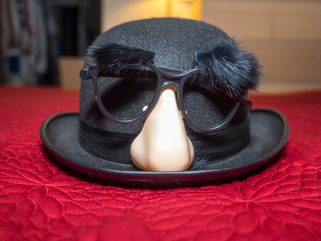 Groucho glasses are a humorous novelty disguise based on the stage makeup that caricature comedian Groucho Marx wore.