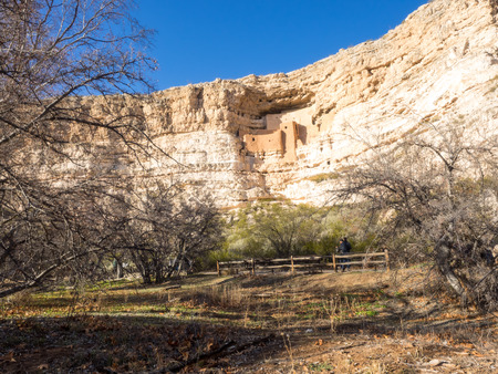Montezuma Castle National Monument protects a set of well-preserved Ancestral Puebloan cliff dwellings near the town of Camp Verde, Arizona, United States. The dwellings were built and used by the Sinagua people, a pre-Columbian culture closely related to Stock Photo
