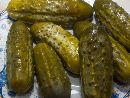 Pickled cucumber is a cucumber that has been pickled in a brine, vinegar, or other solution and left to ferment for a period of time, by either immersing the cucumbers in an acidic solution or through souring by lacto-fermentation.