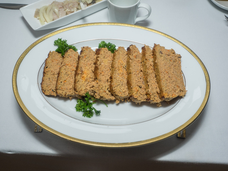Pate is a French word which means a mixture of minced meat and fat. Pate is a form of spreadable paste, generally made from a finely ground or chunky mixture of meats and liver, and often with additional fat, vegetables, herbs, spices or wine.