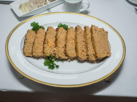 meatloaf: Pate is a French word which means a mixture of minced meat and fat. Pate is a form of spreadable paste, generally made from a finely ground or chunky mixture of meats and liver, and often with additional fat, vegetables, herbs, spices or wine.