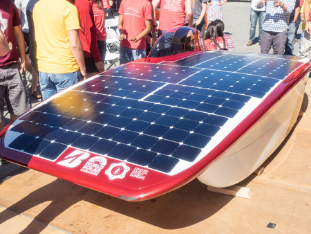unveiling: Stanford, CAUSA - July 1, 2017: The Stanford Solar Car Project unveiling the newest solar powered car, Sundae. The car will race across the Australian Outback as part of the World Solar Challenge.