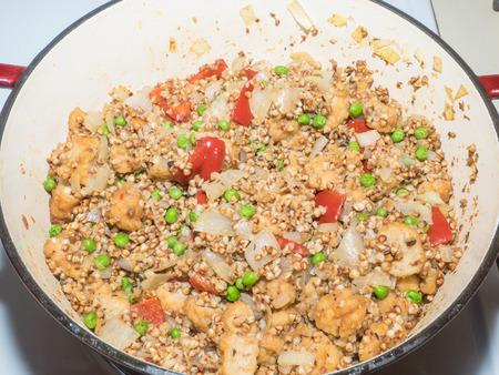 Leftover chicken buckwheat paella is delicious twist on the classic using buckwheat instead of regular paella rice to provide plenty of minerals, antioxidants. Reklamní fotografie