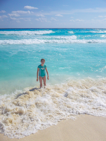 Having fun playing with waves on a beach in Cancun. Stock Photo