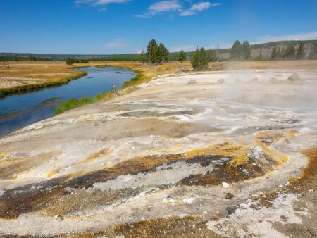 Ojo Caliente Spring is a hot spring in Lower Geyser Basin, of Yellowstone National Park.