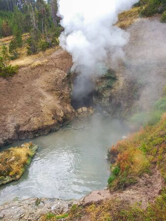 ragon's Mouth is a hot spring. Located to the left just down the boardwalk from Mud Volcano, Dragon's Mouth Spring boils out of a deep cave.