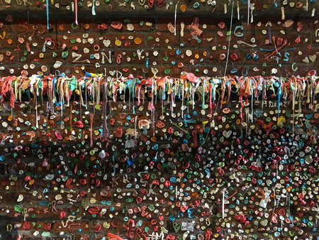 Market Theater Gum Wall is a brick wall covered in used chewing gum located in an alleyway in Post Alley under Pike Place Market in Downtown Seattle.